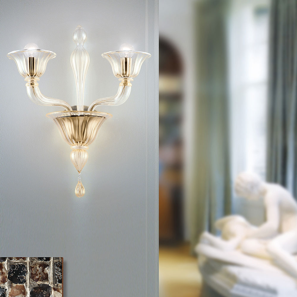 Ouverture wall light in clear Murano glass with a gilded or chrome frame- Luxury lighting Madelia Paris